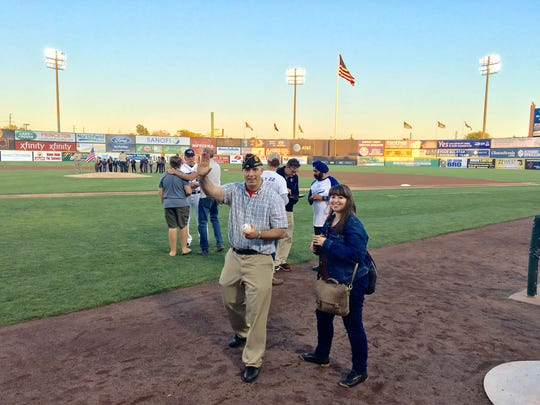 SCVTHS social studies instructor Ed Graf waves after he throws out the first pitch at the Somerset Patriots game on Friday, September 8.