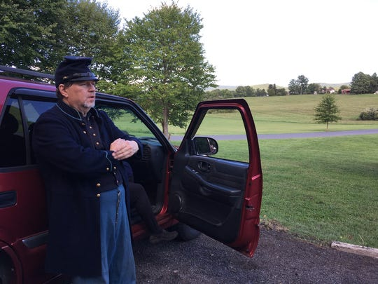 Mark Kindy leans against a car as he looks over the site of the Waynesboro at War event, which will take place at Coyner Springs Park September 16-17, 2017.