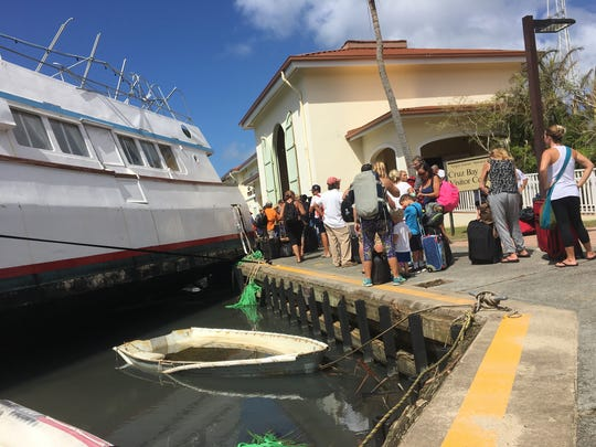 St. John residents line up to evacuate off the island
