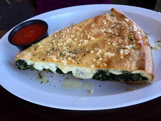 The stuffed spinach pizza at Ryan's comes in an inch-thick, monstrous slice, perfect for spinach-lovers.