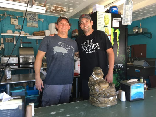 """Adam Clark and Jason Unger opened The Doghouse in June 2015. """"It's a blast,"""" Clark says of running the eatery."""