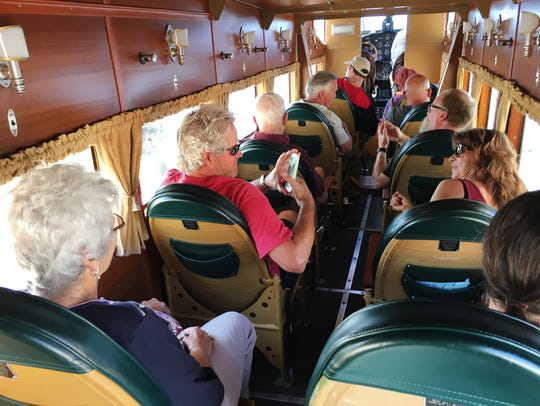 Passengers take a ride on a 1928 Ford Tri-Motor owned