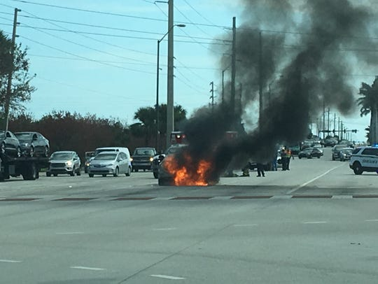 Car fire spotted near Sykes Creek Parkway and State
