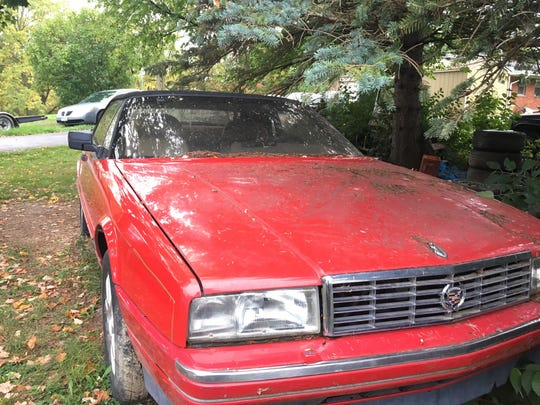 A 1991 Cadillac Allante for sale at Ron Dauzet's property in Northfield Township. He is asking $2,500.