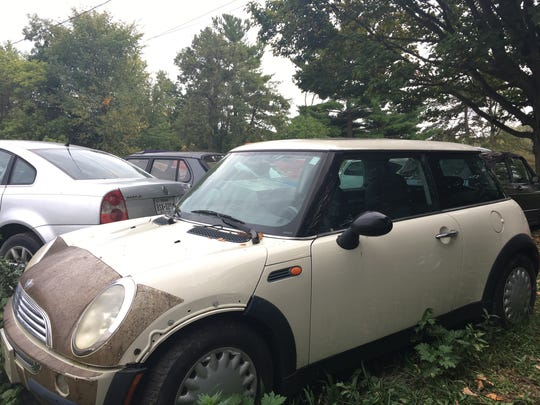 A 2004 Mini Cooper for sale at Ron Dauzet's property in Northfield Township. He is asking $2,000.