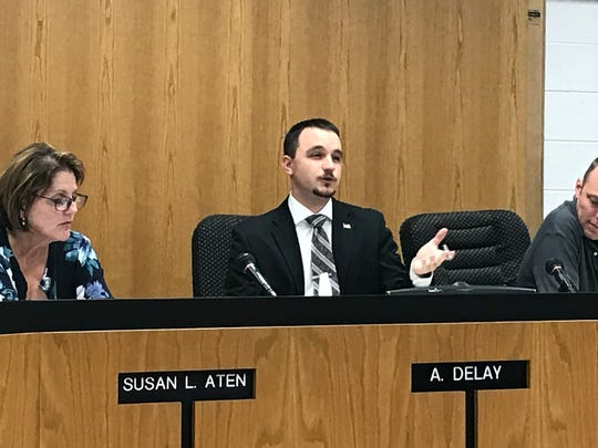 Lansing Twp. Trustree Adam DeLay, right, discusses the township's plan for a special assessment for police and fire needs at the Sept. 5, 2017 meeting. DeLay has asked for a proposal to reduce costs for smaller homes. The board is expected to vote Oct. 17.