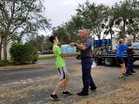Four pallets of water were delivered from Indiana to the Bonita Springs Assistance Office. Firefighters helped make a water chain to bring the bottles into the office.