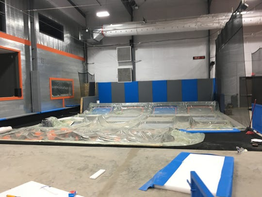 The play area for smaller children, with protective plastic sheeting protecting the area during construction, at Air Madness Trampoline Park in Harrisburg.