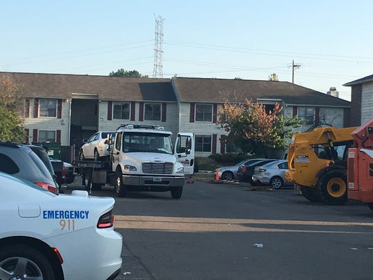 Honda Accord is towed away from Autumnwood Apartments.