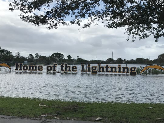After Hurricane Irma, Lehigh Senior High School's entry sign, on a fence, was flooded. The water has receded.
