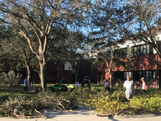 About 50 members of the Lehigh Senior High School staff and faculty showed up on campus to help clean it up after the storm.