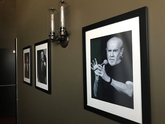 Photos of George Carlin and other comedic legends line the walls at Stir Crazy Comedy Club at the Westgate Entertainment District in Glendale.