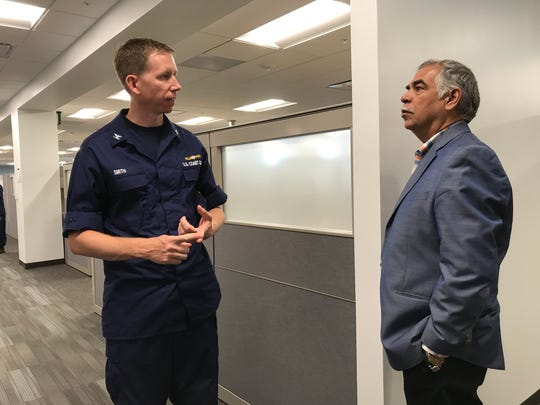 Capt. Jason Smith, deputy sector commander for U.S. Coast Guard Sector/Air Station Corpus Christi, speaks with Corpus Christi International Airport Board member Alex Garcia during a tour of the new Coast Guard facility on Friday at the international airport. The building is scheduled to be fully operational next month.