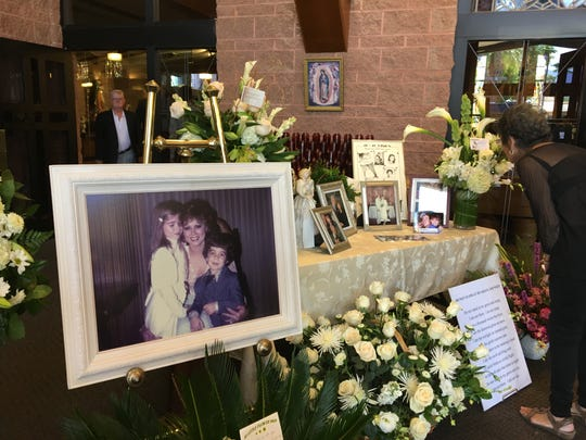 Pattie Daly Caruso's  family photos at the entrance