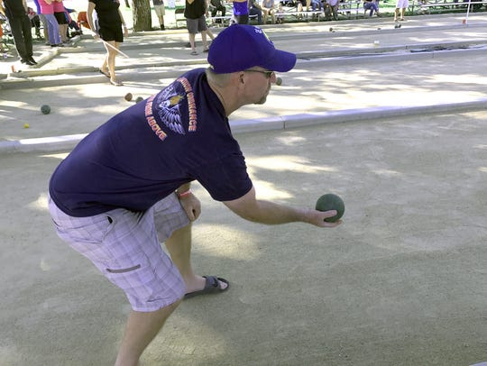 Clay Fisher of The Freds bocce ball team gets ready
