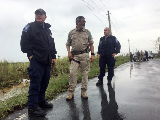 Mike Pruitt, left, and other members of FEMA's Incident
