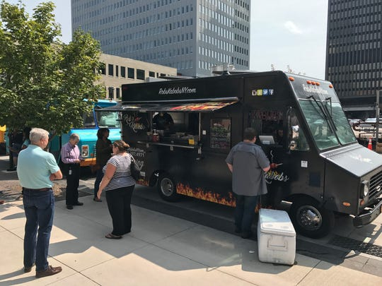 The Rob's Kabobs food truck serves lunch downtown in 2017.