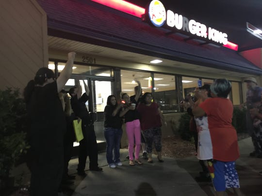 People go on strike outside of Burger King off Southeast