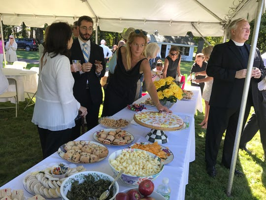 Guests mingle on the grounds of Hartley Farms in Harding