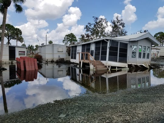 A damaged mobile home sits in flood water in Imperial