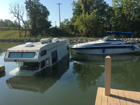 RV goes into Erie Canal attached to boat