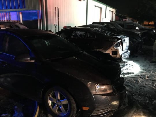 The Murfreesboro Fire Marshal is investigating a suspicious fire a a local body shop where several cars were found engulfed in flames.