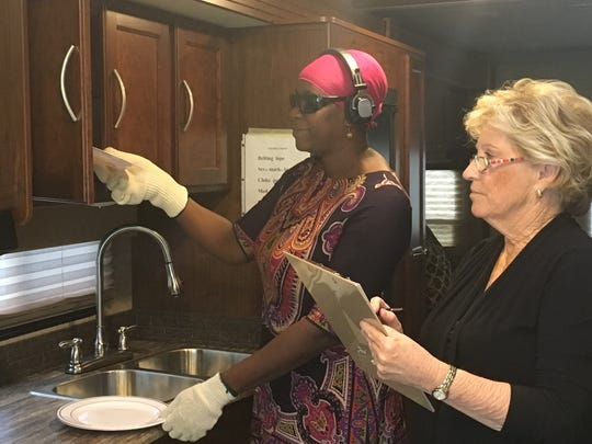 Volunteer and caregiver Alma Luckett is guided by Peggy