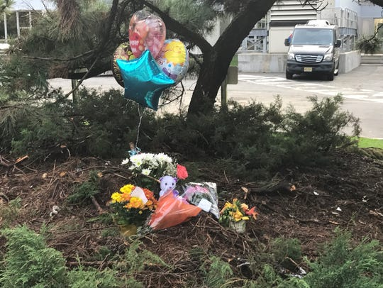 A makeshift memorial popped up at the scene of a horrific