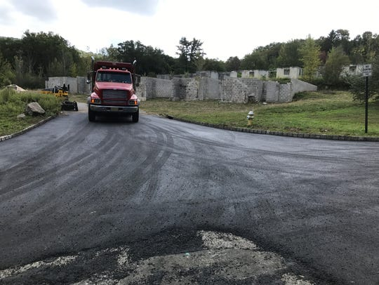 Road paving last year near the Lakeside Manor townhouse site in Wanaque.
