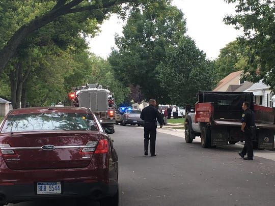 Dearborn police and fire officials block a road in