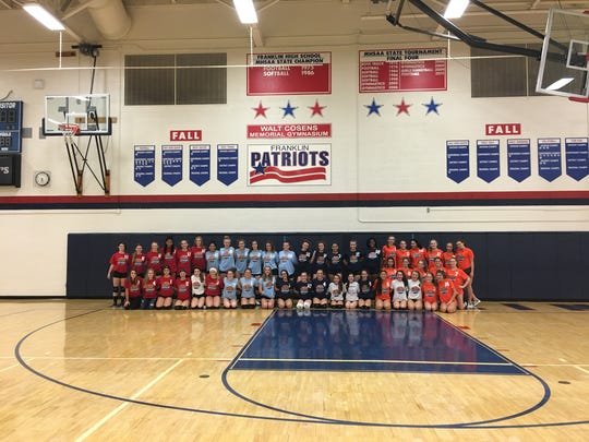 "Varsity, JV and freshman teams for three Livonia high schools and Northville took part in ""Blessings in a Backpack."""