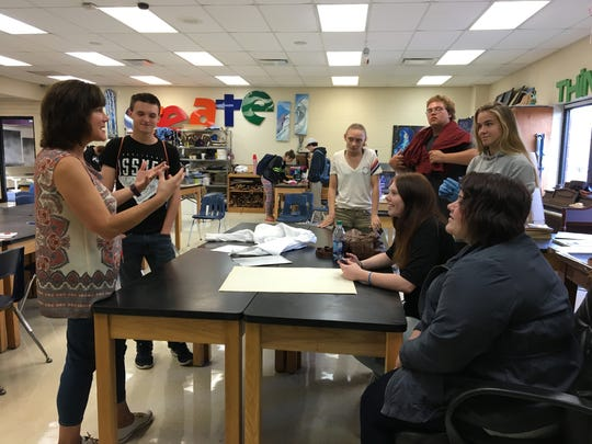 Marine City business owner Laura Scaccia talks with teens at Riverview East on Tuesday. Students from both Riverview East and Marine City High School are working on a project to help turn part of the old Marine City hall into a space for the River Rec Teen Zone group.