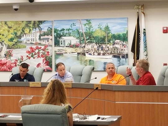 Bonita Springs Mayor Peter Simmons, left, and councilors Peter O'Flinn, Mike Gibson and Fred Forbes discuss how to handle flooding in the city.