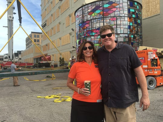 Coakley Brothers Co. CEO Peggy Coakley and Brooklyn, N.Y., artist Tom Fruin stand in front of Fruin's water tower sculpture.