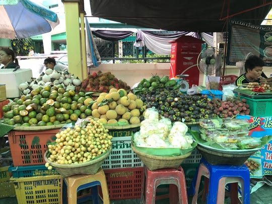 Try all kinds of tropical fruit from street food vendors
