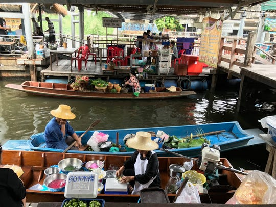 Relax in a tour boat or haggle with vendors at Bangkok's