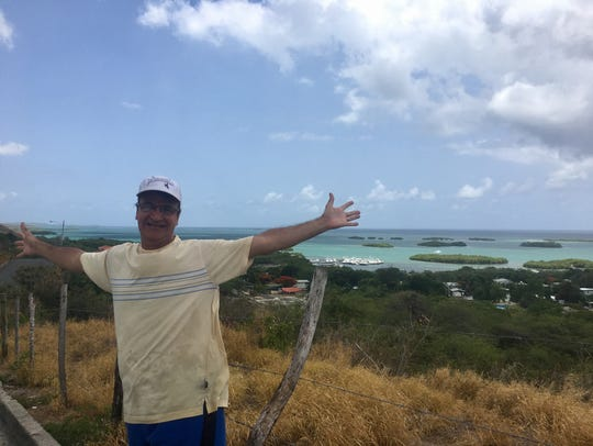 Dr. Ivan Figueroa spreads his arms in La Parguera,