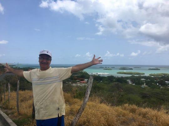Dr. Ivan Figueroa spreads his arms in La Parguera,