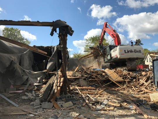 The razing of fire-damaged Fracaro's Lanes on Whitrerock Avenue is underway. A shovel operator was clearing debris Friday, Sept. 29, 2017, at the site. The building was damaged beyond repair in a fire on Jan. 1, 2017.