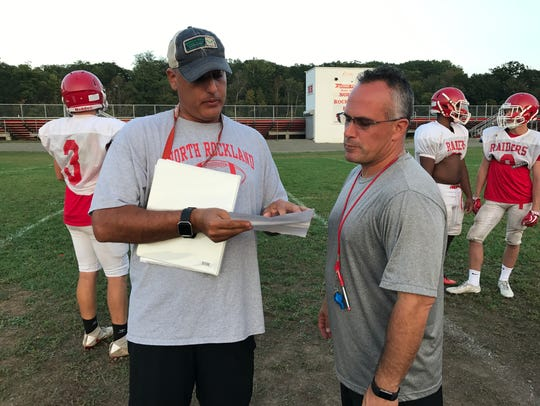 Ralph Tana (right) has been a volunteer coach with