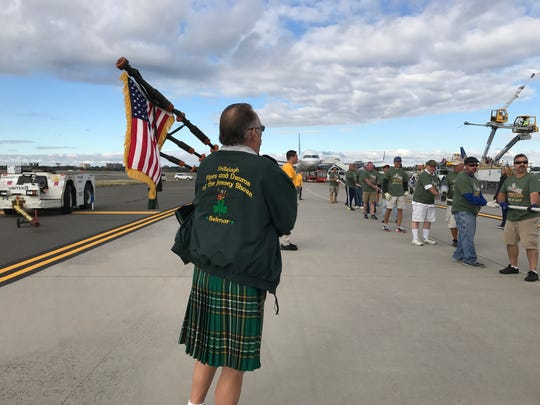 The Shillelagh Tuggers brought their own bagpiper for motivation as they attempted to win the Special Olympics Plane Pull at Newark Liberty International Airport on Saturday.