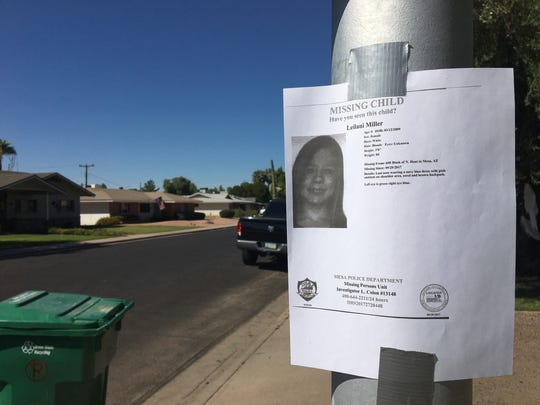 Posters for Leilani Miller, an 8-year-old Mesa girl who went missing, remained taped to light poles and street signs Sept. 30, 2017, the remnants of a two-day search. The girl was found safe.