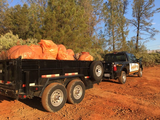 Deputies haul away garbage from Saturday's community