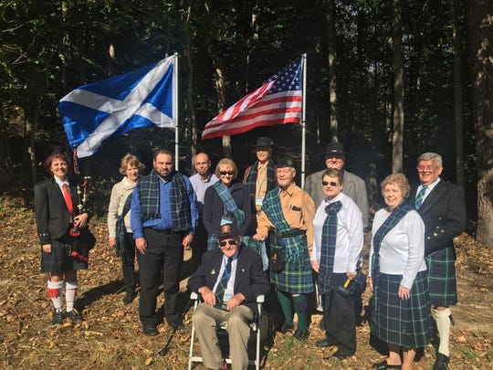 A group gathered to honor Revolutionary War soldier