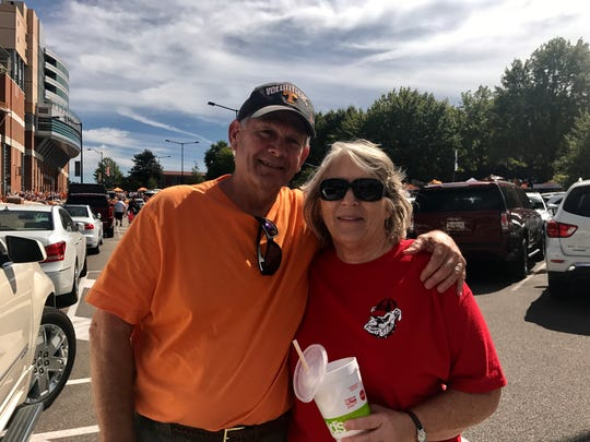 Darrell and Ronda Matheny, of Monroe, Ga. were in favor of opposing teams at the UT Georgia game on Saturday, Sept. 30, 2017. They said the rivalry sparks debate between their families, but it's all in good fun.