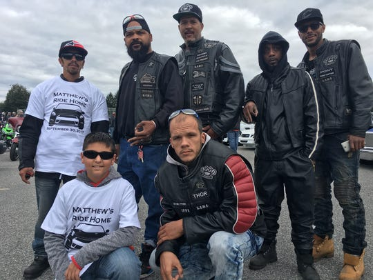 York biker club, Infamous Ryders, stand with Chris