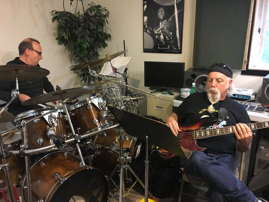 Roger Noonan, right, on bass, and Rob Emanuel, on drums, members of Julianne Ankley & The Rogues, rehearse for their Oct. 6 Lexington Village Theatre performance.