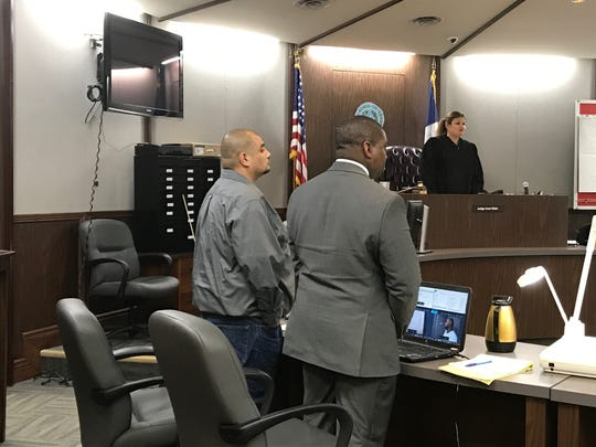 Feliciano Cruz stands in court on the first day of his trail.