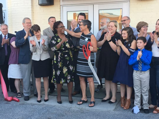 Mayor Kim Bracey and DreamWrights executive director, Ann Davis, cut the ribbon to reveal renovations from the recent $1.8 million capital campaign donation on Thursday, Sept. 28.