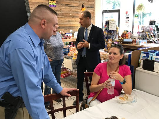 Det. Tom Perrotta talks with citizen Erin Gang during